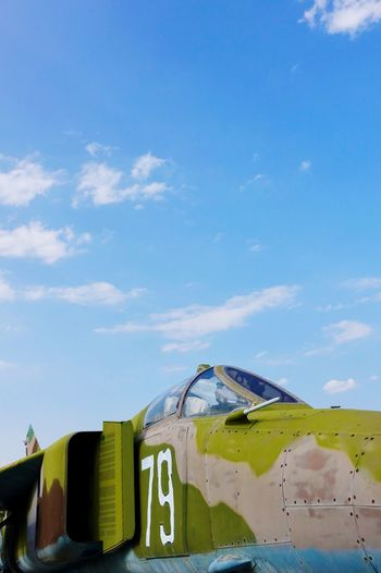 Abandoned airplane against blue sky