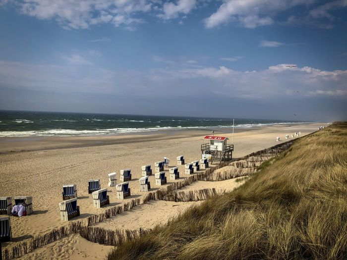 Sky Land Water Sea Beach Horizon Cloud - Sky Scenics - Nature Horizon Over Water Beauty In Nature Nature Sand Tranquil Scene Day Grass Tranquility No People Plant Hooded Beach Chair Outdoors Marram Grass