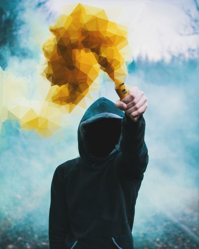smoker Smoke Smoking Yellow Pyrotechnics Fog Foggy Human Body Part Waist Up One Person Adult One Man Only Mid Adult People Men Adults Only Human Hand Only Men Holding Portrait Outdoors