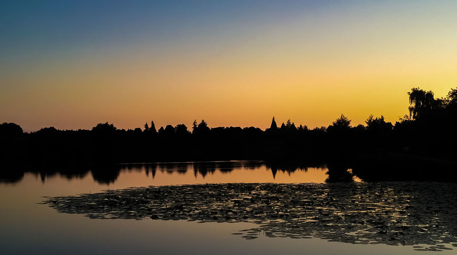 French landscape Beauty In Nature Clear Sky Copy Space Idyllic Lake Nature No People Non-urban Scene Orange Color Outdoors Plant Reflection Scenics - Nature Silhouette Sky Sunset Tranquil Scene Tranquility Tree Water Waterfront