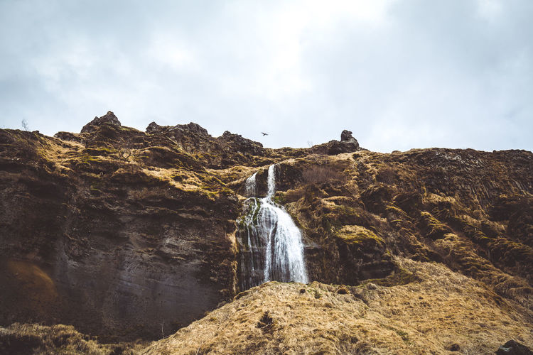 Days of travel: 6 - Seljalandsfoss Iceland Adventure Beauty In Nature Cloud - Sky Day Environment Flowing Flowing Water Iceland_collection Land Long Exposure Motion Mountain Mountain Peak Nature No People Outdoors Rock Rock - Object Rock Formation Scenics - Nature Sky Solid Water Waterfall The Great Outdoors - 2018 EyeEm Awards