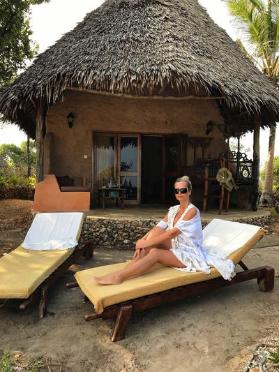 Relaxation Thatched Roof Luxury Tourist Resort Wellbeing Vacations Wealth Hut Travel Serene People Lifestyles Getting Away From It All Women Beauty Full Length Leisure Activity Happiness Destination Beachvilla Resort Africa Evening Tranquility Scenics