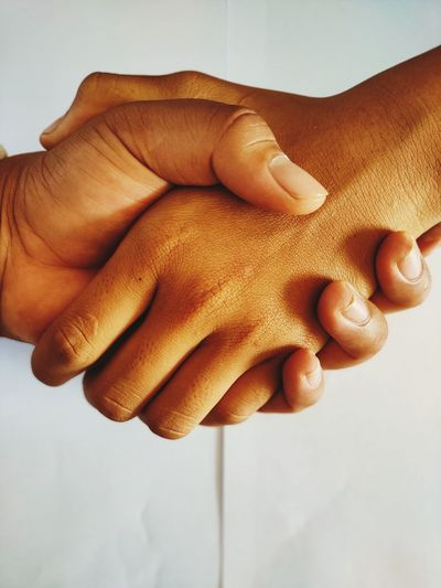 High angle view of hand holding hands