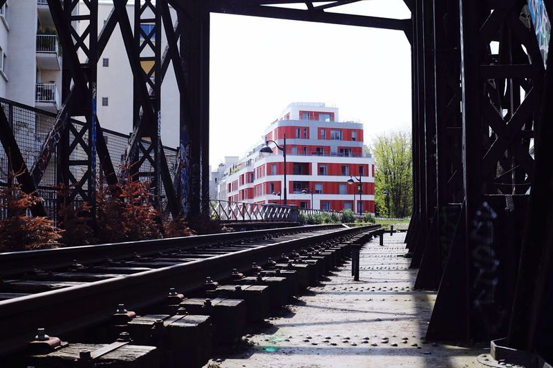 The Architect - 2016 EyeEm Awards Paris France Walking on an old bridge for train whose be abandoned. The contrast with the building out there catches my eyes.. Taking Photos Street Streetphotography Outdoors Exploring Discover Your City Enjoying Life Check This Out Architecture_collection Vscocam Architecture