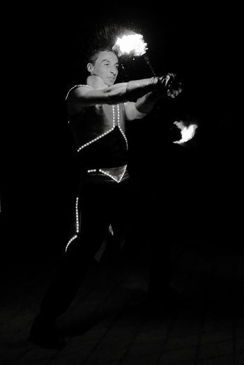 Man playing guitar at night