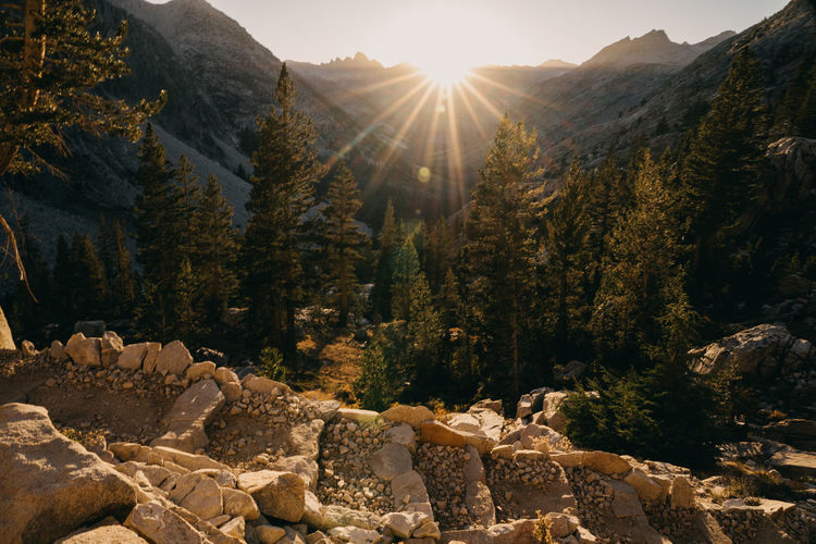 Golden Stairs Sierra Nevada Mountains California Hiking Thru Hiking Sunset Sun Sun Light Mountain Sunlight Rock Beauty In Nature Rock - Object John Muir Trail Pacific Crest Trail Scenics - Nature Tranquility Tranquil Scene Non-urban Scene Mountain Range Flowing Water Outdoors Bright Tree Sunbeam Solid Lens Flare Sky No People Nature Day Plant