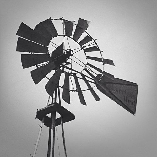 Close up of this old windmill. The writing on the fin says; American West. Windmill American West EyeEm Best Shots - Black + White Black & White