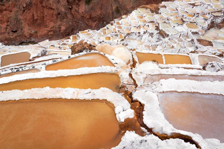 High angle view of salt pools at maras