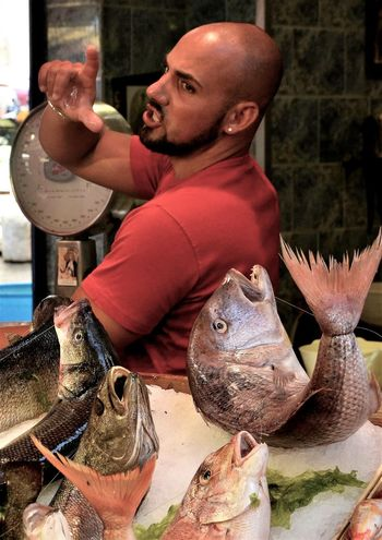 Lifestyles Men One Person Selling Fish Color Explosion Open Air Market Freshness Italy Day Market Stall