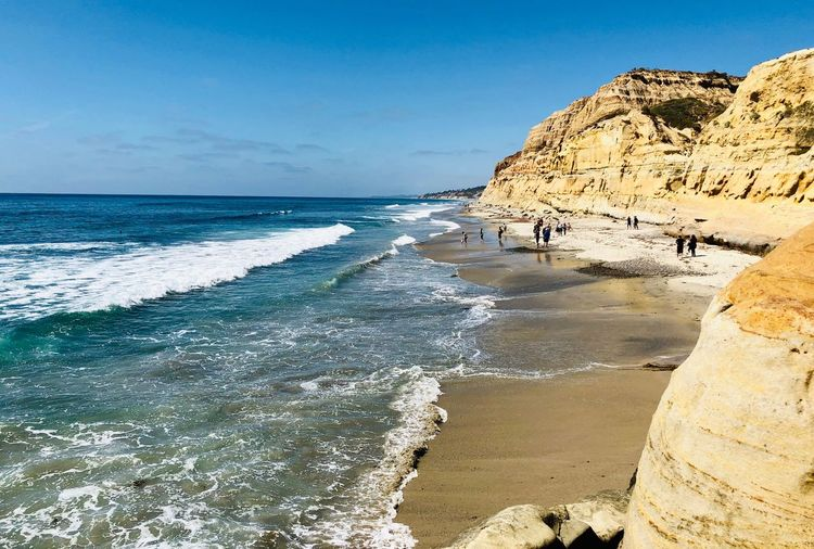 Torrey Pines State Beach Water Sea Beach Land Sky Beauty In Nature Scenics - Nature Horizon Over Water Motion Day Horizon Rock Formation Outdoors Nature Sand Tranquil Scene Wave Rock Tranquility Blue