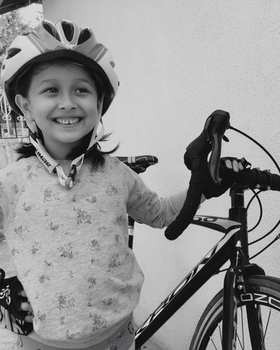 Bicycle Cycling Headwear Looking At Camera Portrait Smiling Transportation Helmet Happiness Riding Mode Of Transport Sports Helmet Childhood Cute Confidence  Lifestyles One Person Standing Real People Cycling Helmet Blackandwhite Girl Child Smile Live For The Story The Portraitist - 2017 EyeEm Awards