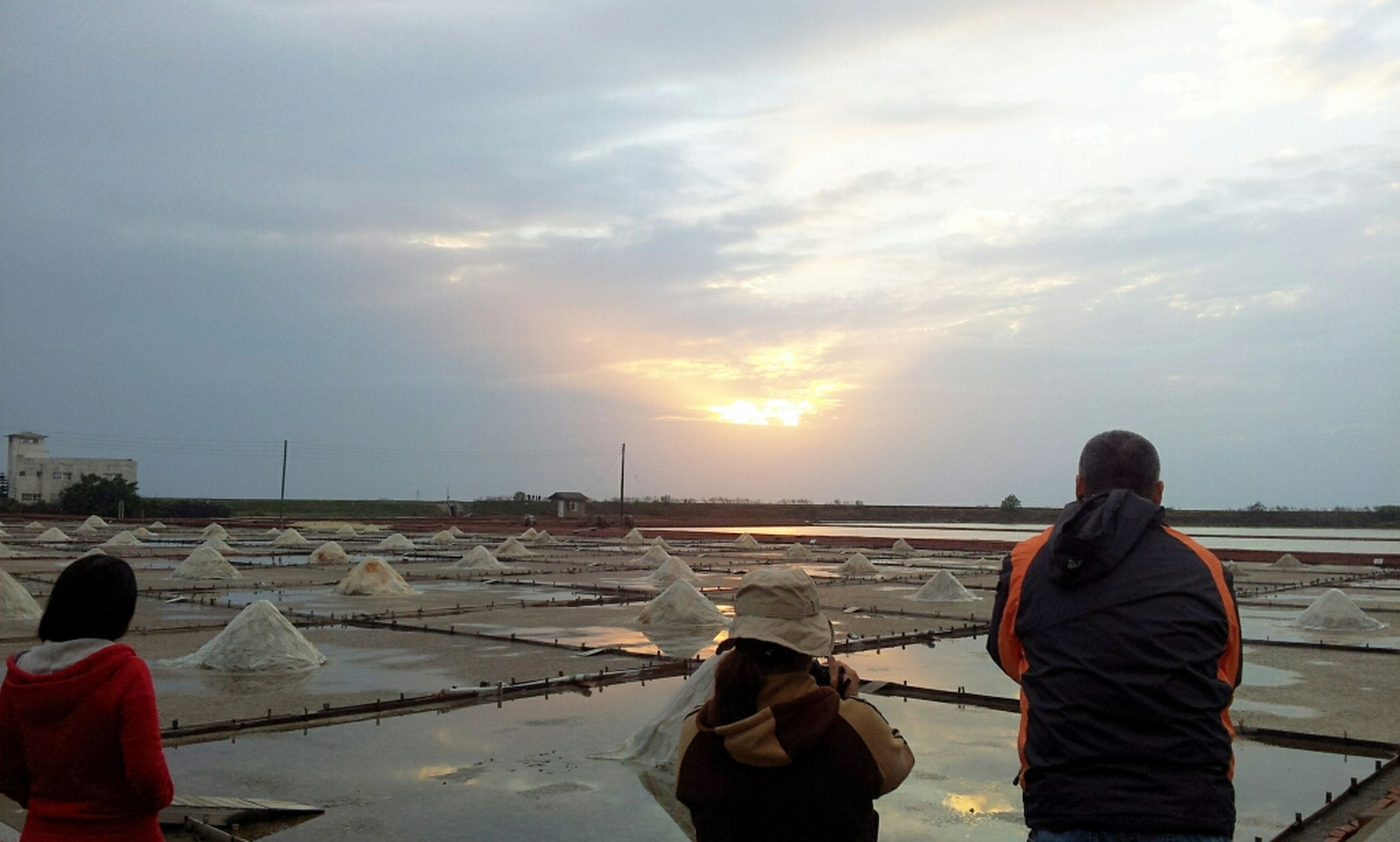 lifestyles, leisure activity, rear view, sky, men, standing, water, casual clothing, cloud - sky, person, sitting, togetherness, nature, three quarter length, warm clothing, sunset, looking at view