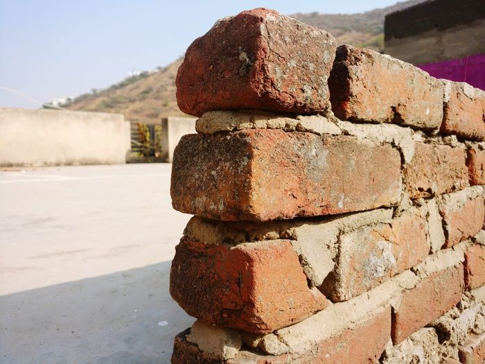Close-up of stack on rock against wall