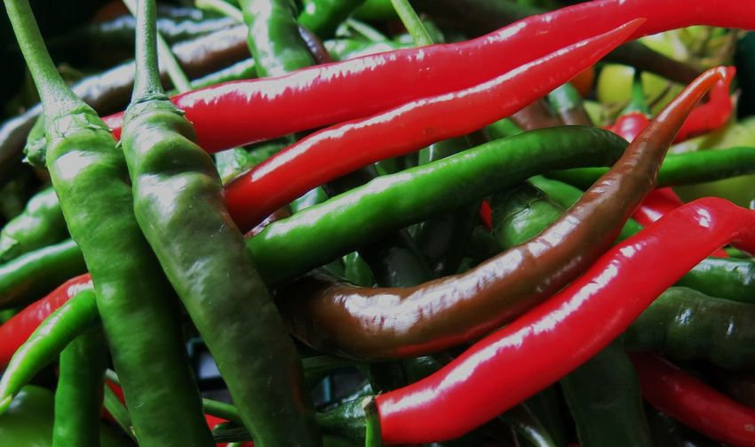 Full frame shot of red and green peppers