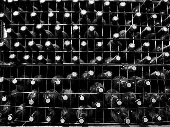 Full frame shot of wine bottles