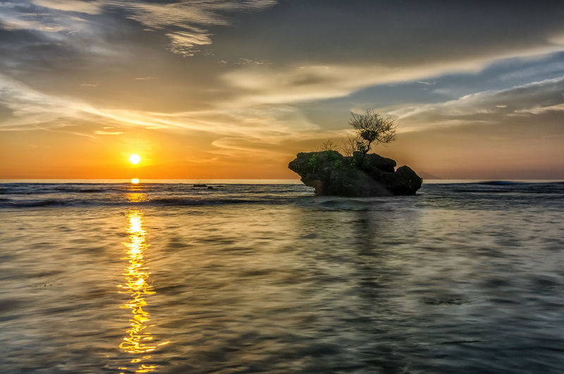 Half of Sunset Moment INDONESIA Beach Beauty In Nature Cloud - Sky Horizon Over Water Idyllic Indonesia_photography Landscape Landscape_photography Nature No People Outdoors Reflection Scenics Sea Silhouette Sky Sun Sunset Tranquil Scene Tranquility Water Waterfront