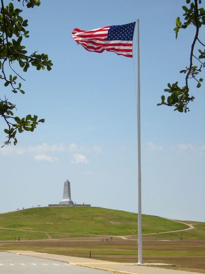 Wright Brothers memorial at Kitty Hawk, North Carolina, a few years ago... Flag Memorial Patriotism No People Architecture Outdoors Day Sky Composition First In Flight Wright Brothers Kitty Hawk OBX North Carolina US Flag Sunny Day
