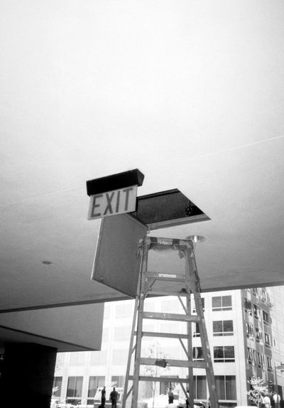 Extreme Exit Exit Exit Sign Monochromatic Urban Funny Signs Black And White Blackandwhite Architecture Building Building Exterior Built Structure City Glass - Material Low Angle View No People Technology Visual Creativity