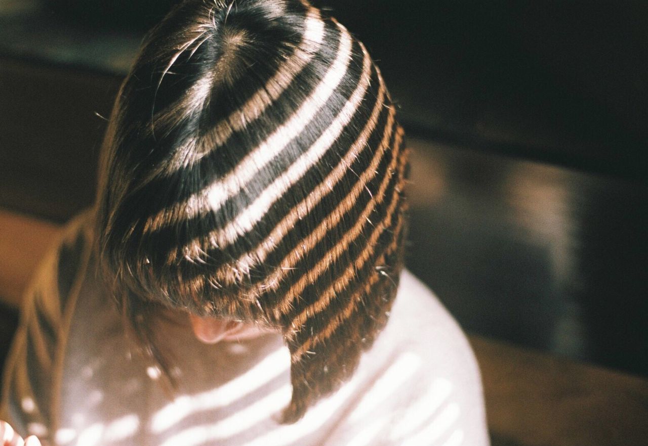 Close-up of woman with striped hair