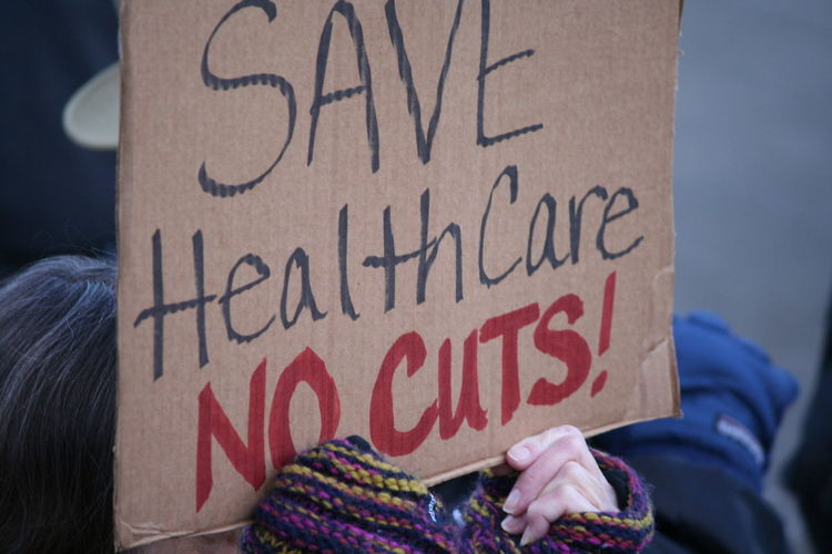Close-Up Of Hand Holding Placard With Message During Protest