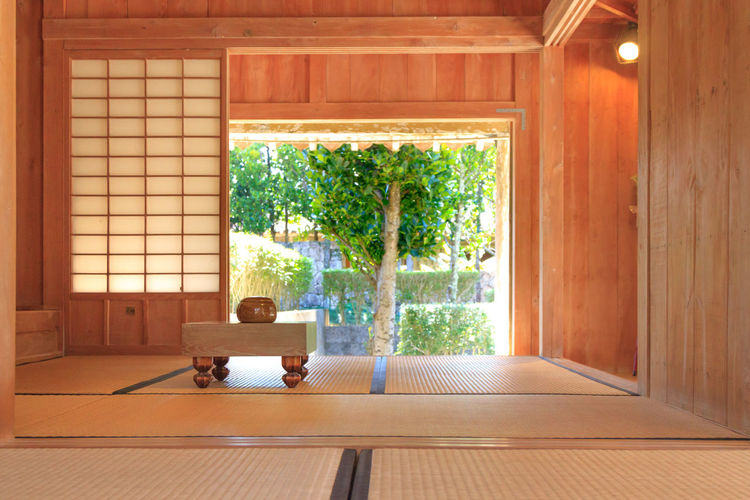 A traditional Japanese room with a Go board Japanese Style Quiet Tatami Tranquility Absence Architecture Built Structure Day Domestic Room Door Entrance Flooring Furniture Home Interior Indoors  Living Room Luxury Nature No People Plant Tree Window Wood - Material