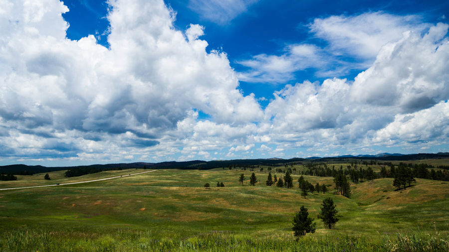 Panoramic Shot Of Countryside Landscape Against Cloudy Sky