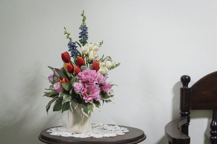 Plastic flowers basked in fluorescent light Arrangement Bouquet Bunch Of Flowers Close-up Decoration Flower Flower Arrangement Flower Head Flowering Plant Freshness Furniture Indoors  Indoors  Petal Plant Still Life Table Vase EyeEmNewHere 2018 In One Photograph