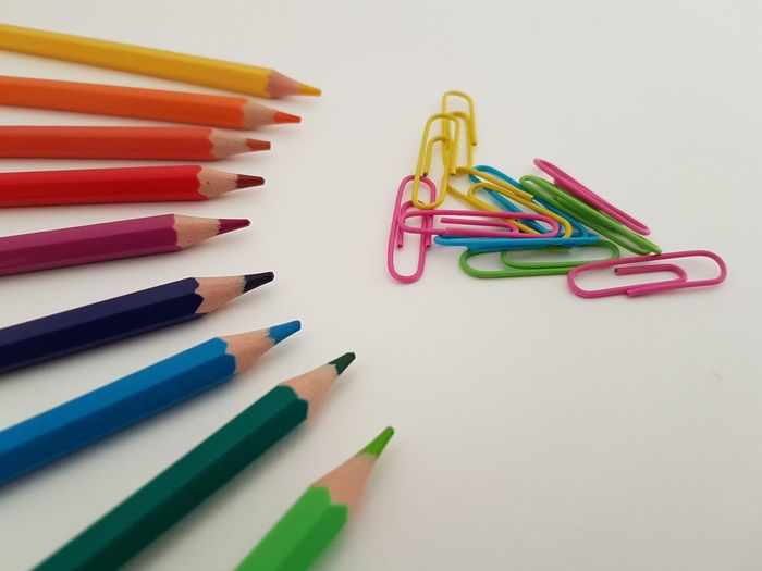 School and office supplies Arts And Crafts Art And Craft Equipment Art Material Choice Close-up Colored Pencil Concept Drawing Tools High Angle View Indoors  Large Group Of Objects Multi Colored No People Office Supply Paper Clips Pencil School School Supplies School Year Stationery Still Life Studio Shot Variation White Background Writing Instrument