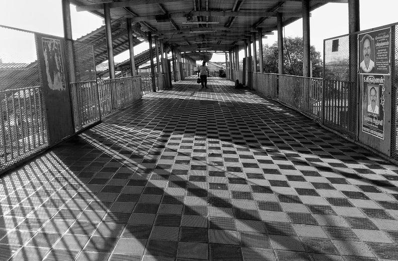 Man walking on tiled floor