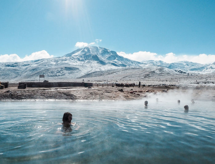 Hot springs in the mountains of the desert Beauty In Nature Cold Temperature Day Hot Spring Landscape Mountain Mountain Range Nature Outdoors Real People Scenics - Nature Sky Snow Snowcapped Mountain Swimming Swimming Pool Tranquil Scene Tranquility Water Waterfront Winter