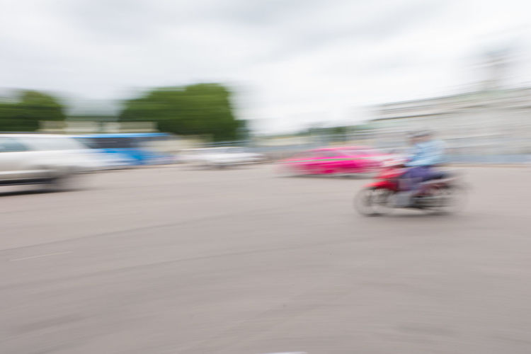 Blurred motion of man on road against sky