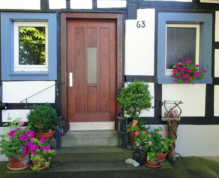 Architecture Building Exterior Built Structure Day Door Flower Flower Pot Freshness Front Door Growth Half-timber House House Houseplant In Front Of Outdoors Plant Potted Plant Residential Building Residential Structure Window