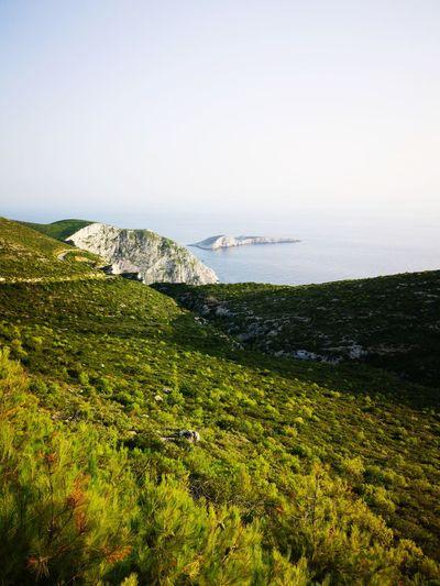 Road to Porto Vromi😍 Greece Porto Vromi Huaweip20pro Huawei Water Sea Beach Sand Sky Grass Horizon Over Water Landscape Coastal Feature Seascape Rocky Coastline Coastline Coast Ocean