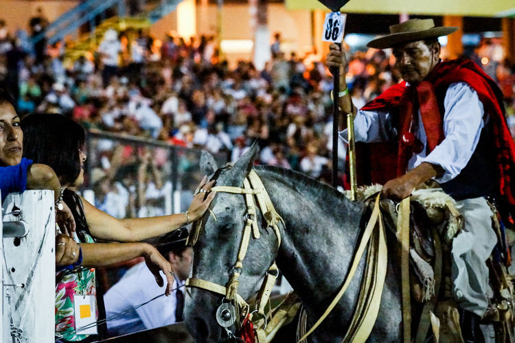 Rider with his horse showing the public the National Festival of Doma and Folklore 2015 in the theater akin Jesus Maria, Argentina on Thursday night January 8, 2015