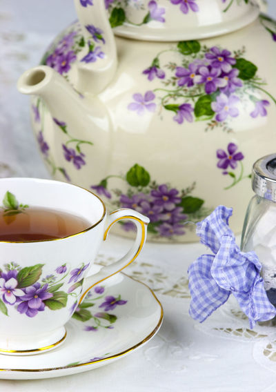 Close-up of elegant retro teapot on table