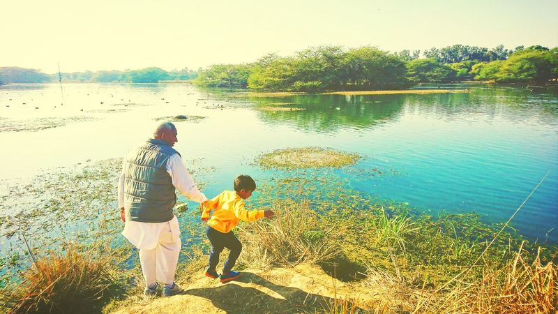 Family Love Water Family With One Child Grandpa Sunny Day Togetherness Standing Lake Outdoors Vacations Childhood Nature