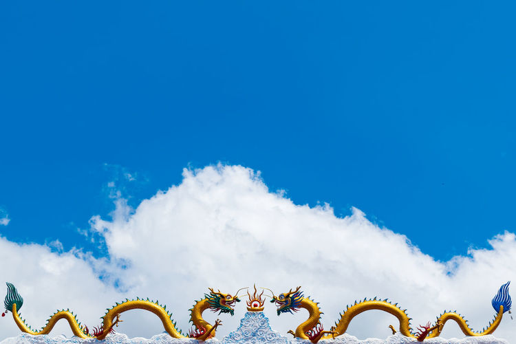 Copy Space Temple Cultures Mythology Statue Sculpture Chinese Dragon Copy Space Backgrounds Dragon Day Freshness Blue Sky Still Life Cloud Cloud - Sky Colors Colorful Outdoors Decoration Blue Multi Colored Sky Cumulus Sky Only Chinese Lantern Scenics Bauble Overcast Migrating