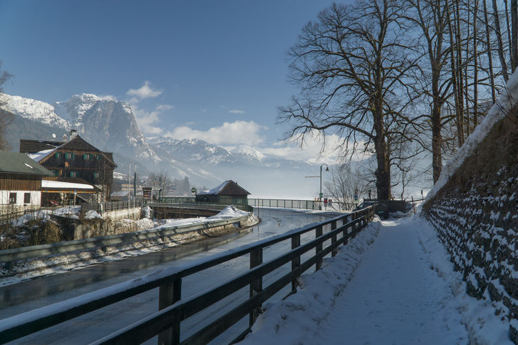 Cold Days Steiermark Austria Grundlsee Bad Aussee Winter Cold Temperature Snow Architecture Built Structure Mountain Sky Bare Tree Building Exterior Water Nature Tree No People Scenics - Nature Beauty In Nature Building Day Snowcapped Mountain Outdoors Canal