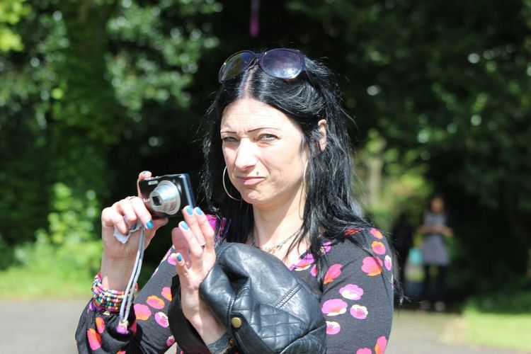 Mid adult woman with digital camera