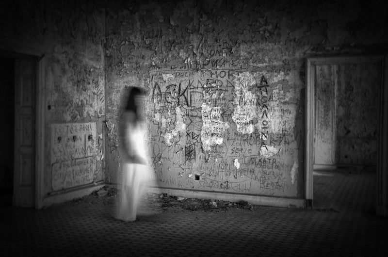 By Anna Wacker Abandoned Places Dilapidated House Ghost Spirit Spirituality Abandoned Adult Architecture Blurred Motion Building Built Structure Decayed Beauty Dress Eerie Scene Full Length Indoors  Lifestyles Motion Night One Person Real People Walking Wall Wall - Building Feature Women