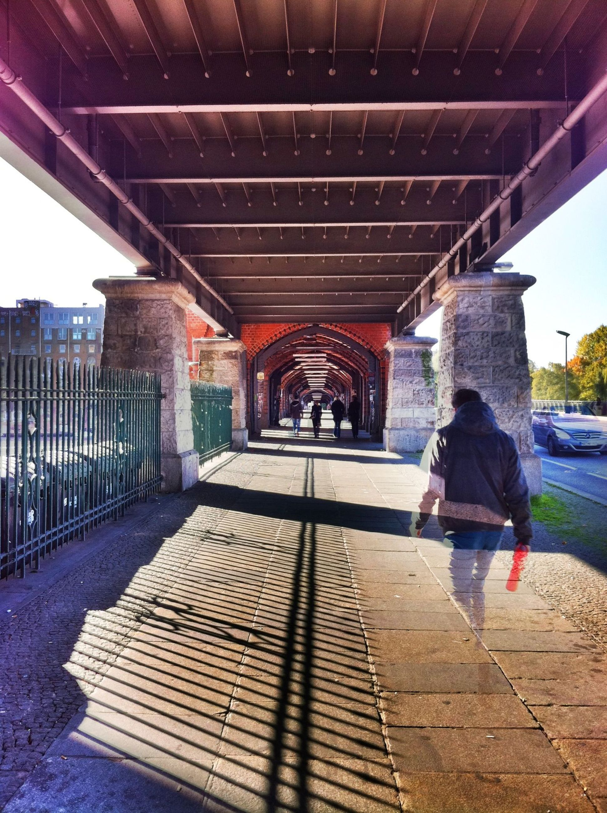 built structure, full length, architecture, lifestyles, rear view, the way forward, leisure activity, men, person, walking, arch, architectural column, casual clothing, sunlight, sky, day, travel