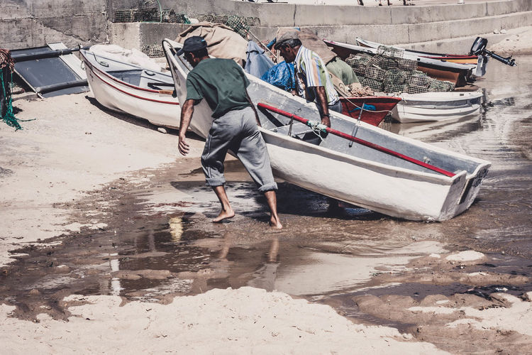 Fishermen Nautical Vessel Water Men Working Real People Day Land Outdoors Casual Clothing Beach Fishing Industry Fishing Boat Sea Beachphotography Boats Tourism