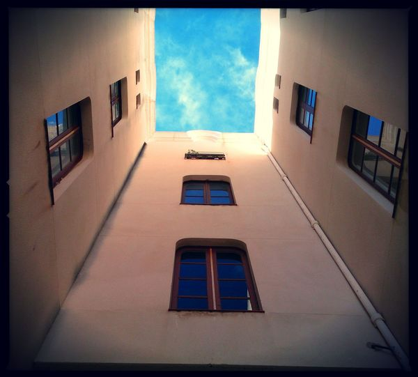 Look up to the exit. Mobilephotography XPERIA Architecture No People Pixlr Lumiocam Outdoors Low Angle View Architecture Residential Building Vanishing Point Cloudy Skies