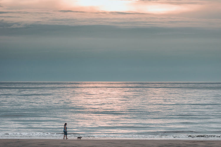 Beach Beauty In Nature Cloud - Sky Horizon Horizon Over Water Land Men Nature One Person Outdoors Real People Scenics - Nature Sea Sky Standing Sunset Tranquil Scene Tranquility Water