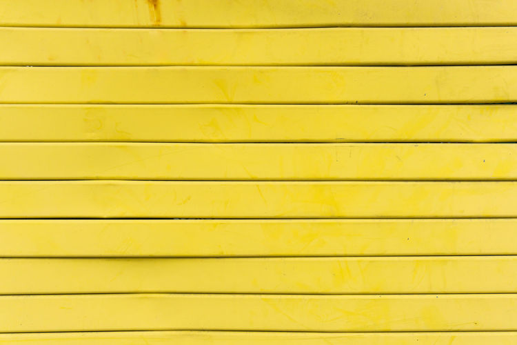 Abstract Architecture Backgrounds Close-up Closed Full Frame In A Row Metal No People Outdoors Pattern Protection Repetition Shutter Striped Textured  Textured Effect Wall - Building Feature Wood - Material Yellow