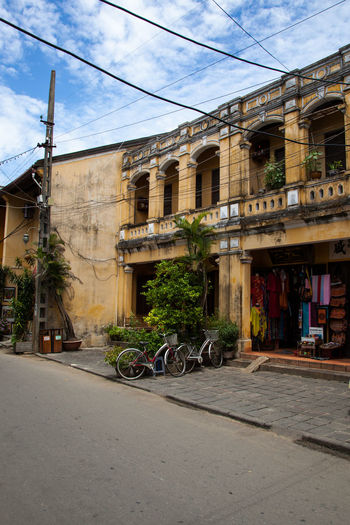 Old District Powerlines Beautiful Building  Built Structure City Shop Electricity  Historic Buildings  Old Building  Power Line  Residential District Road Shop Street Tailor City Tailor Store Untouched During Vietnam War