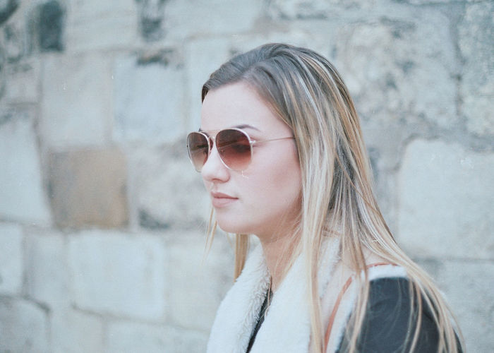 A 35 mm shot from my Generation Z series shot in York - Shot on Canon T70 #NotYourCliche Blonde Brick Wall Fashion Shades Woman Architecture Brick Close-up Day Fashion Photography Fur Hair Highlights Highlights Millennial Millennials Mood Moody Ombre One Person Real People Sunglasses Woman Portrait Young Adult Young Women Stories From The City Inner Power