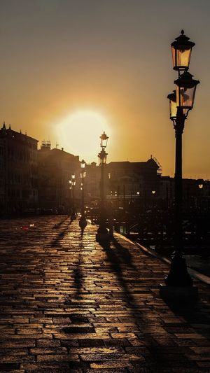 Shadows of lanterns at sunrise in Venice Shadow Venice City Beautiful