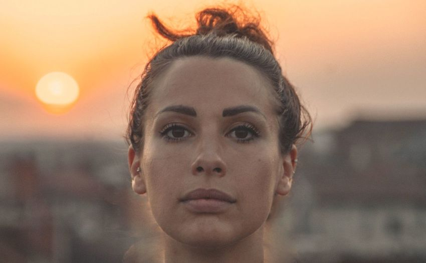 BACK TO THE SUN Sunset Portrait Of A Woman Girl The Portraitist - 2019 EyeEm Awards Portrait Beautiful Woman Beauty Sunset Human Face Young Women Headshot Women Looking At Camera Human Eye Eyeball Thoughtful Eyelid Introspection Freckle Eyebrow Iris - Eye Vision Eyesight Skin Care Day Dreaming