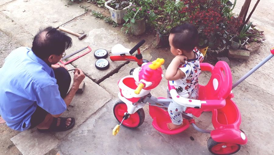 High angle view of people sitting in toy